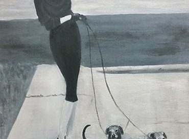 A lady walking her dogs