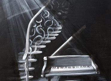 Spotlighted piano next to an ornate staircase